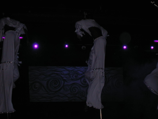 Stiltwalkers doing tricks